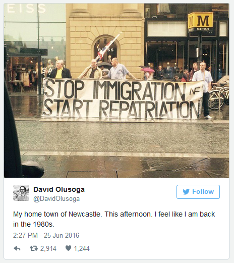 """Protesters with banner """"Stop Immigration; Start repatriation"""" outside a morrisons store in Newcastle"""
